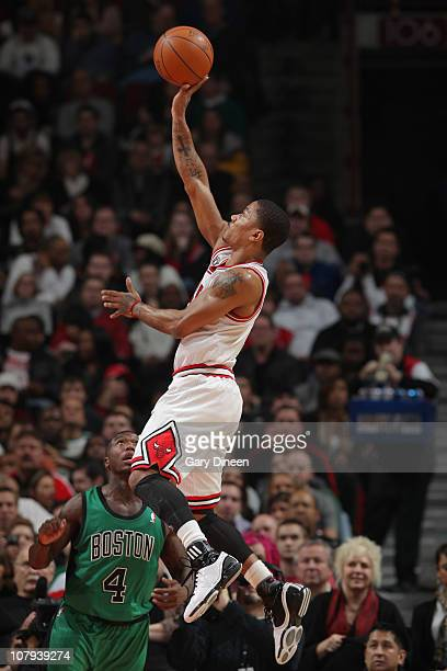 Derrick Rose of the Chicago Bulls shoots against Nate Robinson of the Boston Celtics on January 8 2011 at the United Center in Chicago Illinois NOTE...