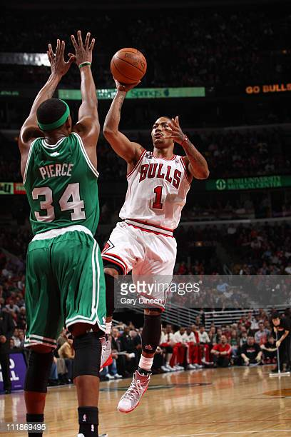 Derrick Rose of the Chicago Bulls shoots against Paul Pierce the Boston Celtics on April 7 2011 at the United Center in Chicago Illinois NOTE TO USER...
