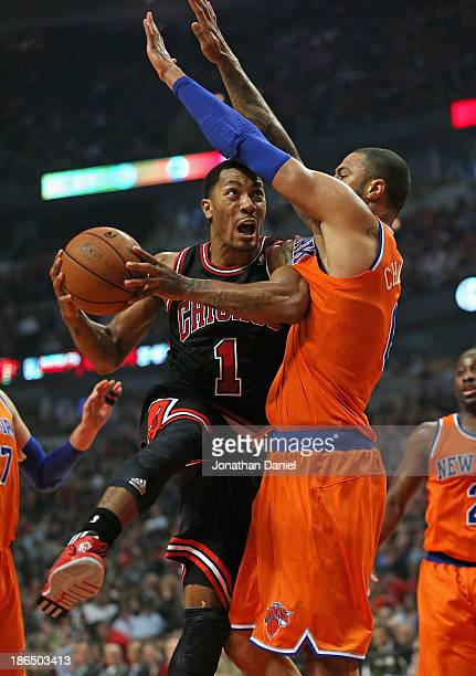 Derrick Rose of the Chicago Bulls shoots against Tyson Chandler of the New York Knicks at the United Center on October 31 2013 in Chicago Illinois...