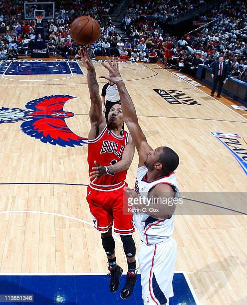 Derrick Rose of the Chicago Bulls shoots over Al Horford of the Atlanta Hawks in Game Four of the Eastern Conference Semifinals in the 2011 NBA...