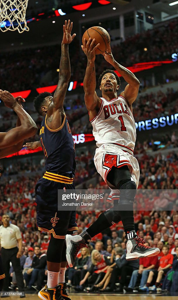 Derrick Rose #1 of the Chicago Bulls shoots over Iman Shumpert #4 of the Cleveland Cavaliers on his way to a game-high 30 points in Game Three of the Eastern Conference Semifinals of the 2015 NBA Playoffs at the United Center on May 8, 2015 in Chicago, Illinois. The Bulls defeated the Cavaliers 99-96.