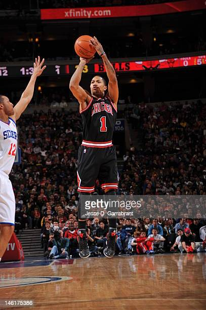 72cc8758eb1a Derrick Rose of the Chicago Bulls shoots the ball against Evan Turner of  the Philadelphia 76ers