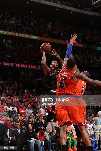 Derrick Rose of the Chicago Bulls shoots the game winning basket over Tyson Chandler and Raymond Felton of the New York Knicks on October 31 2013 at...