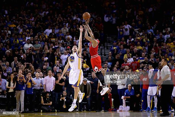 Derrick Rose of the Chicago Bulls shoots the gamewinning basket over Klay Thompson of the Golden State Warriors in overtime at ORACLE Arena on...
