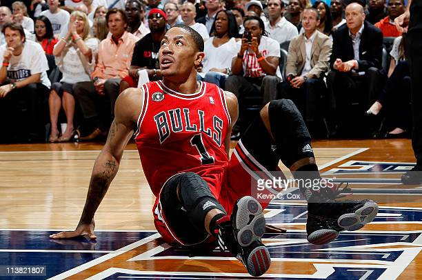 Derrick Rose of the Chicago Bulls sits on the floor after defending the basket against the Atlanta Hawks in Game Three of the Eastern Conference...