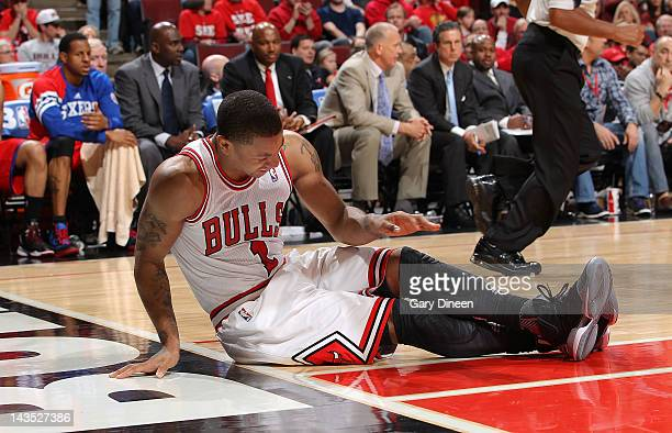 Derrick Rose of the Chicago Bulls sits on the floor after injuring his knee against the Philadelphia 76ers in Game One of the Eastern Conference...