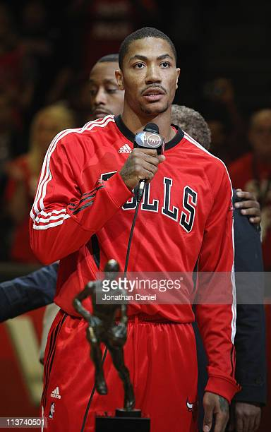 Derrick Rose of the Chicago Bulls speaks to the crowd in front of the Maurice Podoloff Trophy awarded to the NBA Most Valuable Player before taking...
