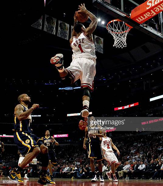 Derrick Rose of the Chicago Bulls takes a pass and leaps to dunk the ball against the Indiana Pacers at the United Center on February 24, 2010 in...