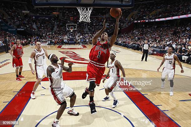 Derrick Rose of the Chicago Bulls takes the ball to the basket past LeBron James of the Cleveland Cavaliers during the game on November 5, 2009 at...