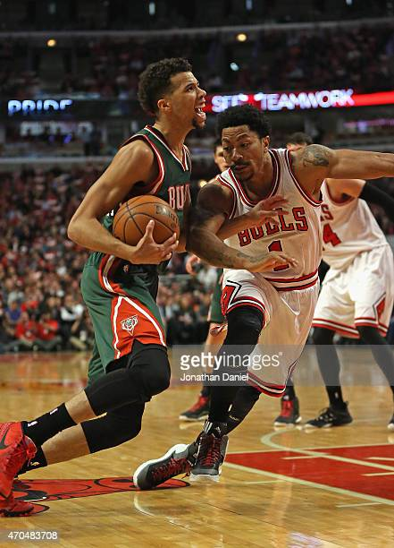 Derrick Rose of the Chicago Bulls tires to slow down Michael CarterWilliams of the Milwaukee Bucks during the first round of the 2015 NBA Playoffs at...