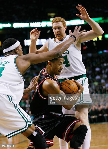 Derrick Rose of the Chicago Bulls tries to make his way through Paul Pierce and Brian Scalabrine of the Boston Celtics at the TD Garden on January 14...