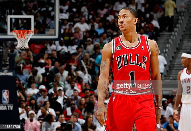 Derrick Rose of the Chicago Bulls walks down court after scoring against the Atlanta Hawks in Game Three of the Eastern Conference Semifinals in the...