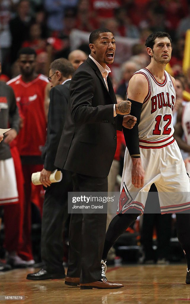 45f14ab28949 Derrick Rose of the Chicago Bulls yells encouragement to his... News ...