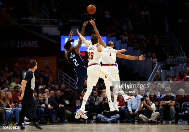 Derrick Rose of the Cleveland Cavaliers and Kyle Korver of the Cleveland Cavaliers attempt to block the shot of Elfrid Payton of the Orlando Magic at...