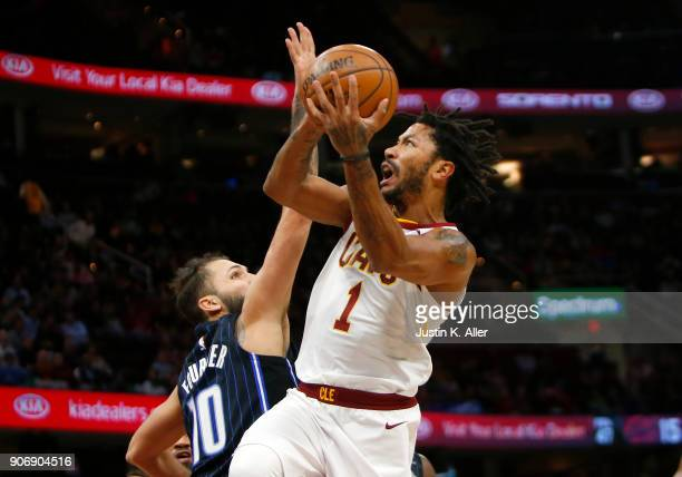 Derrick Rose of the Cleveland Cavaliers drives the lane against Evan Fournier of the Orlando Magic at Quicken Loans Arena on January 18 2018 in...
