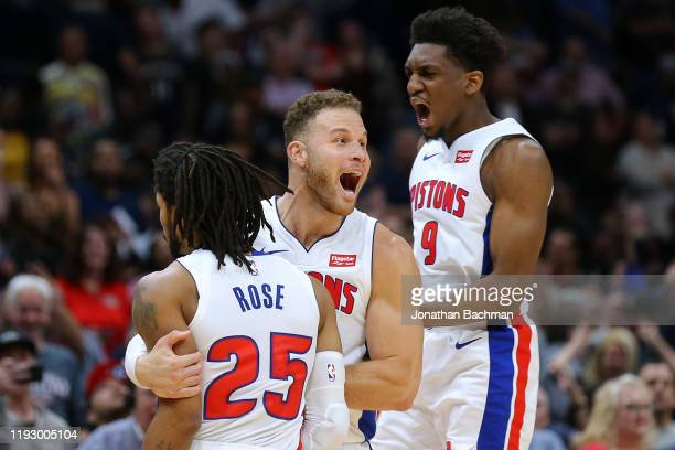 Derrick Rose of the Detroit Pistons celebrates a game winning score with Blake Griffin and Langston Galloway against the New Orleans Pelicans at the...