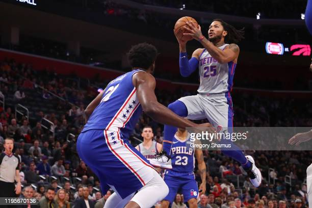 Derrick Rose of the Detroit Pistons drives to the basket against Joel Embiid of the Philadelphia 76ers during the first half at Little Caesars Arena...