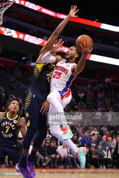 Derrick Rose of the Detroit Pistons drives to the basket against Myles Turner of the Indiana Pacers for the game winning basket at Little Caesars...