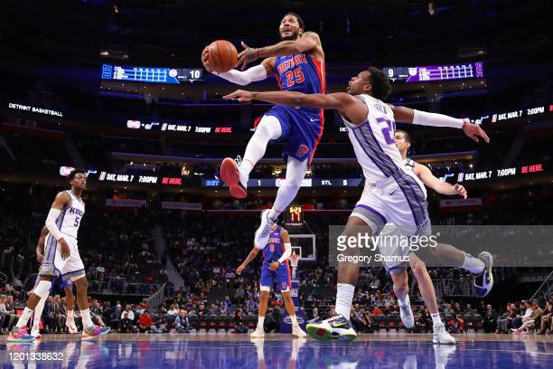 Derrick Rose of the Detroit Pistons drives to the basket past Buddy Hield of the Sacramento Kings during the second half at Little Caesars Arena on...