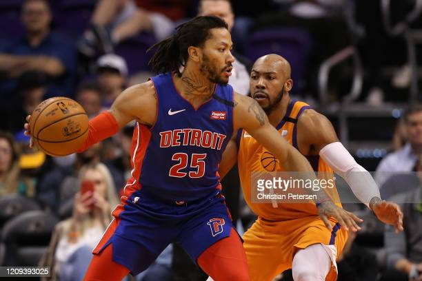 Derrick Rose of the Detroit Pistons handles the ball against Jevon Carter of the Phoenix Suns during the second half of the NBA game at Talking Stick...