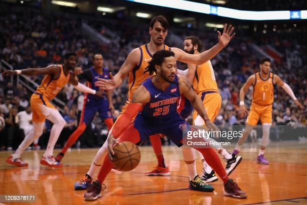 Derrick Rose of the Detroit Pistons handles the ball guarded by Dario Saric of the Phoenix Suns during the first half of the NBA game at Talking...