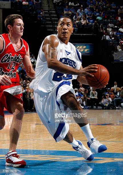 Derrick Rose of the Memphis Tigers drives to the basket against Matt Francis of the CBU Buccaneers during an exhibition game at FedExForum on...