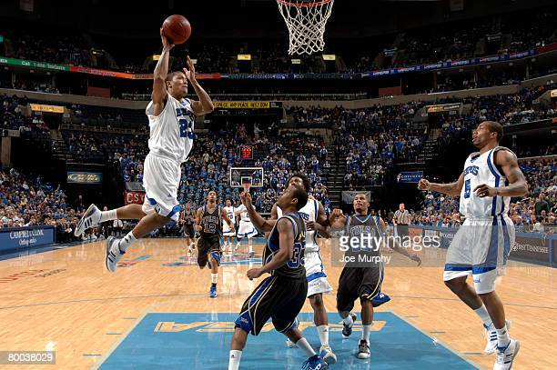 Derrick Rose of the Memphis Tigers drives to the basket for a dunk against Rod Earls of the Tulsa Golden Hurricane at FedExForum on February 27 2008...