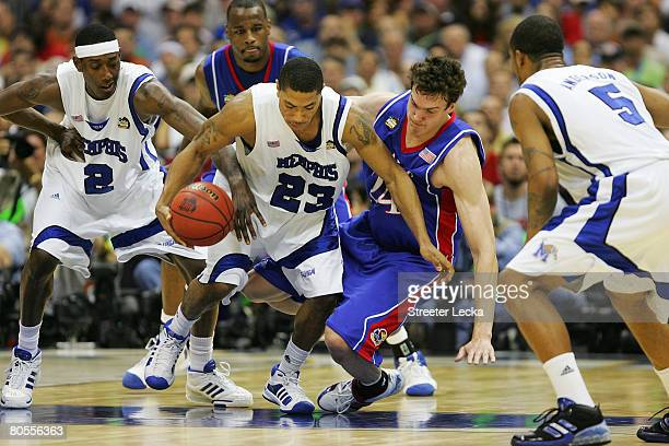 Derrick Rose of the Memphis Tigers fends off Sasha Kaun of the Kansas Jayhawks for posession of the ball in the first half during the 2008 NCAA Men's...