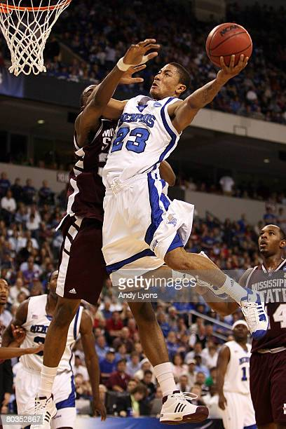 Derrick Rose of the Memphis Tigers shoots over Jarvis Varnado of the Mississippi State Bulldogs during the second round of the South Regional as part...