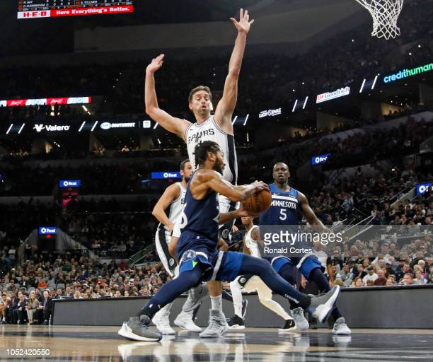 Derrick Rose of the Minnesota Timberwolves drives in front of Pau Gasol of the San Antonio Spurs in season opener at ATT Center on October 17 2018 in...