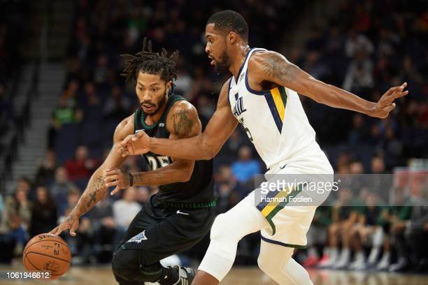 fde997b5367e Derrick Rose of the Minnesota Timberwolves drives to the basket against  Derrick Favors of the Utah