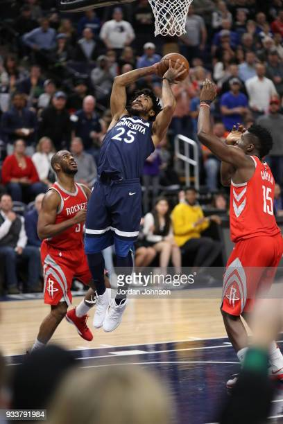 Derrick Rose of the Minnesota Timberwolves dunks against the Houston Rockets on March 18 2018 at Target Center in Minneapolis Minnesota NOTE TO USER...