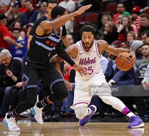 Derrick Rose of the Minnesota Timberwolves moves around Shaquille Harrison of the Chicago Bulls at the United Center on December 26 2018 in Chicago...