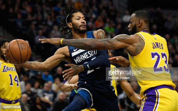 Derrick Rose of the Minnesota Timberwolves passes the ball away from LeBron James of the Los Angeles Lakers during the fourth quarter of the game on...