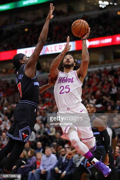 Derrick Rose of the Minnesota Timberwolves puts up a shot against Justin Holiday of the Chicago Bulls at the United Center on December 26 2018 in...