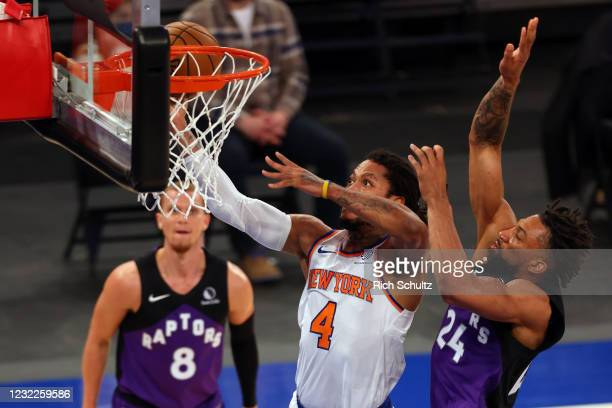 Derrick Rose of the New York Knicks attempts a shot as Khem Birch of the Toronto Raptors defends at Madison Square Garden on April 11, 2021 in New...