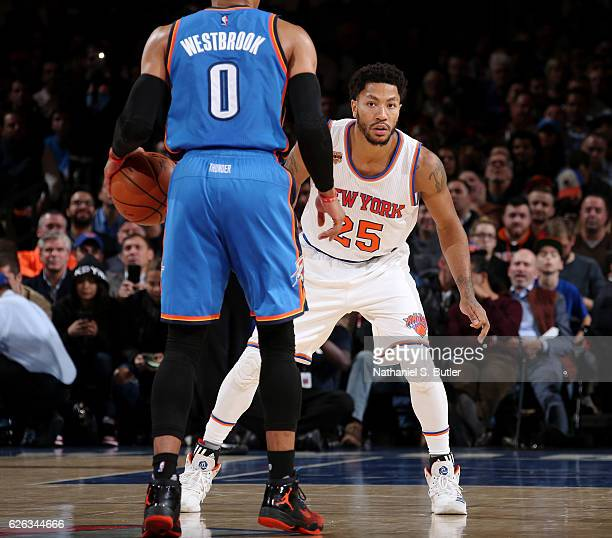 535250b8588d Derrick Rose of the New York Knicks defends against Russell Westbrook of  the Oklahoma City Thunder