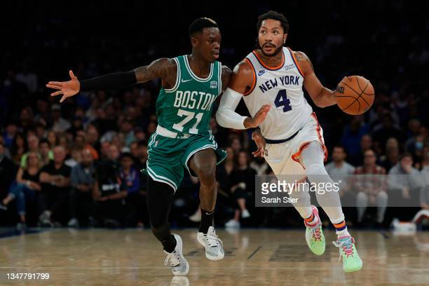 Derrick Rose of the New York Knicks dribbles against Dennis Schroder of the Boston Celtics during the first half at Madison Square Garden on October...