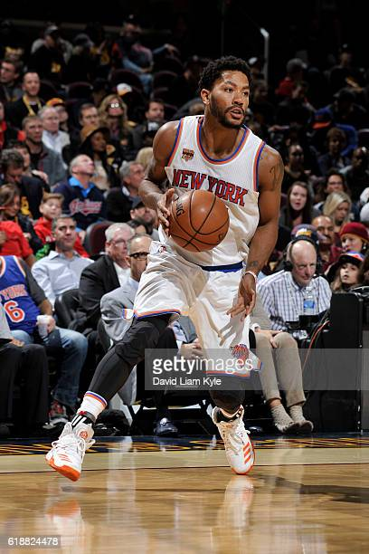 Derrick Rose of the New York Knicks dribbles the ball against the Cleveland Cavaliers on October 25 2016 at Quicken Loans Arena in Cleveland Ohio...