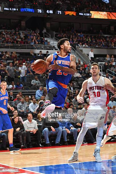 Derrick Rose of the New York Knicks drives to the basket and passes the ball against the Detroit Pistons on November 1 2016 at The Palace of Auburn...