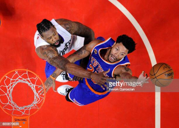 Derrick Rose of the New York Knicks goes for a basket as he is defended by DeAndre Jordan of the Los Angeles Clippers during the second half of the...