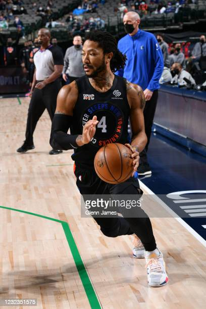 Derrick Rose of the New York Knicks handles the ball during the game against the Dallas Mavericks on April 16, 2021 at the American Airlines Center...
