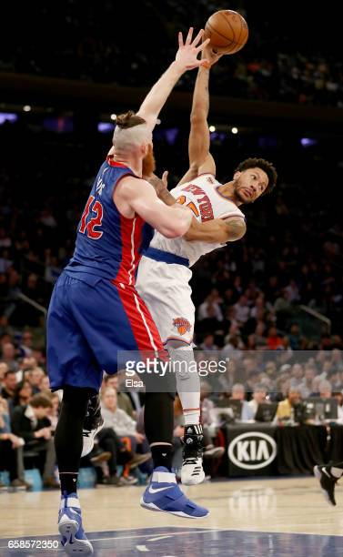 Derrick Rose of the New York Knicks passes the ball as Aron Baynes of the Detroit Pistons defends at Madison Square Garden on March 27 2017 in New...