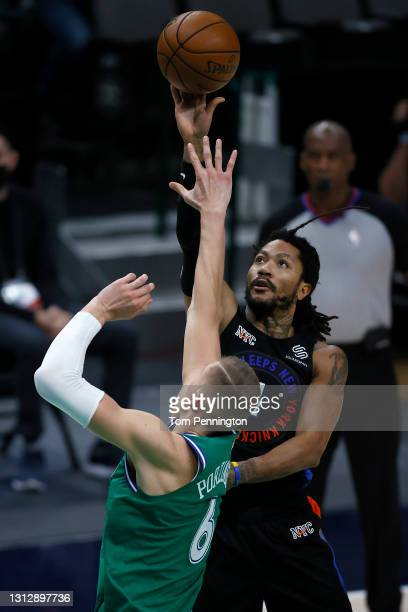 Derrick Rose of the New York Knicks shoots the ball against Kristaps Porzingis of the Dallas Mavericks in the third quarter at American Airlines...