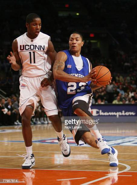Derrick Rose of the University of Memphis Tigers drives against Jerome Dyson of the University of Connecticut Huskies during the College Hoops...