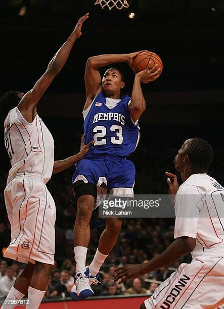 Derrick Rose of the University of Memphis Tigers lays the ball up against the University of Connecticut Huskies during the College Hoops Classic...