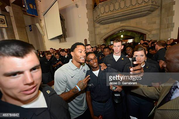 Derrick Rose of the USA Basketball Men's National Team poses for a photo with a cadet on August 18 2014 at West Point in New York New York NOTE TO...