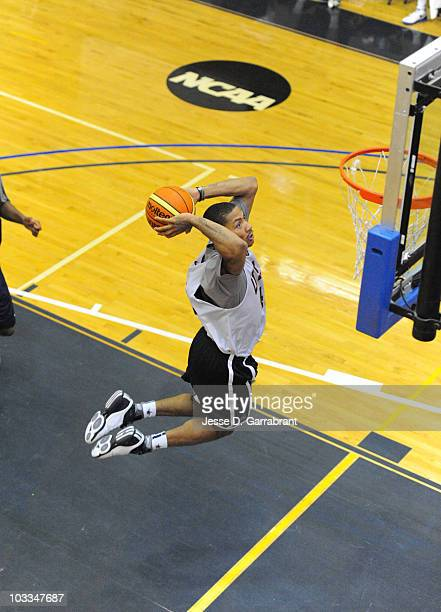 Derrick Rose of the USA Men's National Team dunks during practice on August 11 2010 at John Jay College in New York New York NOTE TO USER User...