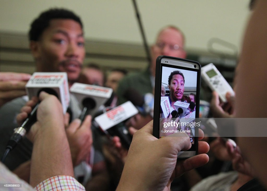 Derrick Rose, wearing #28, speaks to the media after a USA basketball training session at Quest MultiSport Complex on August 15, 2014 in Chicago, Illinois.