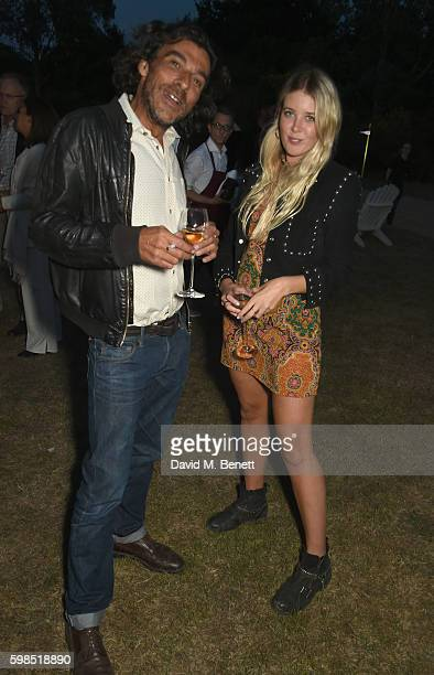 Derrick Santini and Gracie Egan attend Krug Island a food and music experience hosted by Krug champagne on September 1 2016 in Maldon England